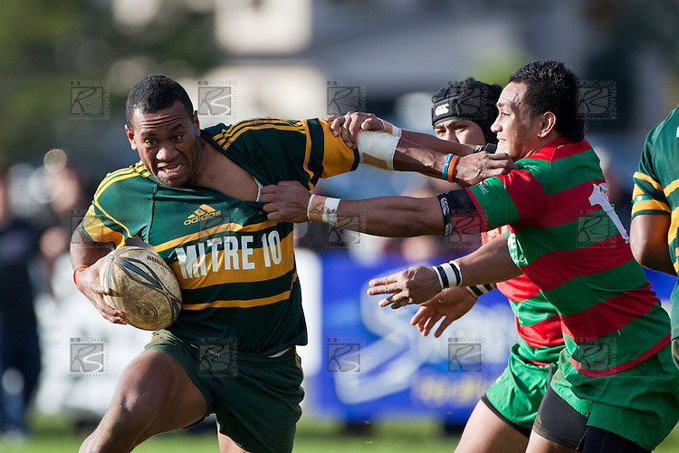 David Raikuna fends off the tackle os Sio Petelo. Counties Manukau Premier Club Rugby game between Pukekohe and Waiuku played at Colin Lawrie Fields, Pukekohe, on Saturday July 3rd 2010. Pukekohe won 31 - 12 after leading 15 - 9 at halftime.