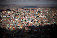A panoramic view of El Alto.Just 25 years ago it was a small group of houses around La Paz  airport, at an altitude of 12,000 feet. Now El Alto city  has  nearly one million people, surpassing even the capital of Bolivia, and it is the city of Latin America that grew faster ...It is also a paradigmatic city of the troubles  and traumas of the country. There got refugee thousands of miners that lost  their jobs in 90 ¥s after the privatization and closure of many mines. The peasants expelled by the lack of land or low prices for their production. Also many who did not want to live in regions where coca  growers and the Army  faced with violence...In short, anyone who did not have anything at all and was looking for a place to survive ended up in El Alto...Today is an amazing city. Not only for its size. Also by showing how its inhabitants,the poorest of the poor in one of the poorest countries in Latin America, managed to get into society, to get some economic development, to replace their firs  cardboard houses with  new ones made with bricks ,  to trace its streets,  to raise their clubs, churches and schools for their children...Better or worse, some have managed to become a sort of middle class, a section of the society that sociologists call  emerging sectors. Many, maybe  most of them, remain for statistics as  poor. But clearly  all of them have the feeling they got  for their children a better life than the one they had to face themselves .