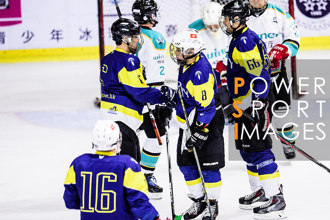 Verity Skater #8 Ken Kan (l) celebrates with teammates after scoring during the Principal Standard League match between Medical Winner Kings vs Verity at the Mega Ice on 17 January 2017 in Hong Kong, China. Photo by Marcio Rodrigo Machado / Power Sport Images