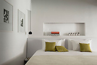 Above the bed in one of the bedrooms there is a contemporary take on the traditional Moroccan alcove