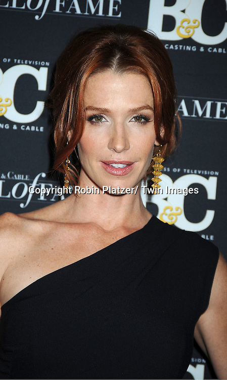 Poppy Montgomery in black Ralph Lauren attends the 2011 Broadcasting & Cable Hall of Fame Awards on October 26, 2011 at the Waldorf Astoria Hotel in New York City.