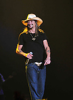 "Kid Rock was on fire for his performance  at the Jackson Coliseum in Jackson Mississippi as the second to last night of his ""Born Free"" tour Friday March 11,2011. Kid played the guitar, keyboards and drums during his almost 2 hour show filled with strippers, pyro technics, old photo slide show and laser lights . Kid Rock  was joined on stage by country guitarist Jamey Johnson and Randy Houser. Kid Rock, who grew up in in Detroit,  turned 40 years old and is celebrating his birthday All Tour Long and the last show of the tour is Saturday night March 12,2011 in Memphis TN.   Photo©Suzi Altman"