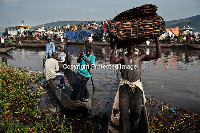 MALUKU, DEMOCRATIC REPUBLIC OF CONGO APRIL 26: Unidentified people disembark a boat on April 26, 2006 in the port in Maluku, Congo, DRC. About five hundred people traveled for seven weeks on the Congo River. A distance of about1750 kilometers from Kisangani to Kinshasa. The port is a small port about 50 kilometers from the capital Kinshasa. Many villagers come here to trade goods. The Congo River is a lifeline for millions of people, who depend on it for transport and trade. Congo is planning to hold general elections by July 2006, the first democratic elections in forty years. (Photo by Per-Anders Pettersson)