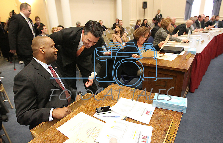 Nevada Assemblyman William Horne, D-Las Vegas, and Gov. Brian Sandoval look at all the signatures in a historic desk before the Assembly floor session held in the old Assembly chamber at the Capitol in Carson City, Nev. on Thursday, March 10, 2011..Photo by Cathleen Allison
