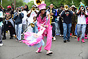 Nicole Tate leads the Hot 8 Brass Band during the Single Ladies Social Aid and Pleasure Club's annual secondline uptown, 2018