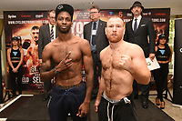 Asinia Byfield (L) and Gabor Gorbics during a Cyclone Promotions Weigh-In at the Grosvenor House Hotel on 6th October 2017