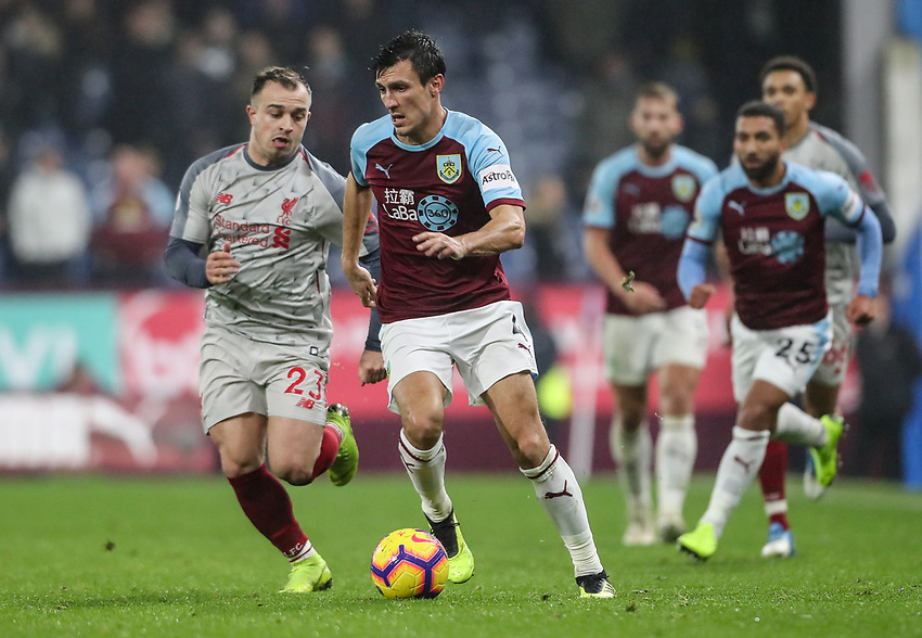 Burnley's Jack Cork competing with Liverpool's Xherdan Shaqiri<br /> <br /> Photographer Andrew Kearns/CameraSport<br /> <br /> The Premier League - Burnley v Liverpool - Wednesday 5th December 2018 - Turf Moor - Burnley<br /> <br /> World Copyright © 2018 CameraSport. All rights reserved. 43 Linden Ave. Countesthorpe. Leicester. England. LE8 5PG - Tel: +44 (0) 116 277 4147 - admin@camerasport.com - www.camerasport.com