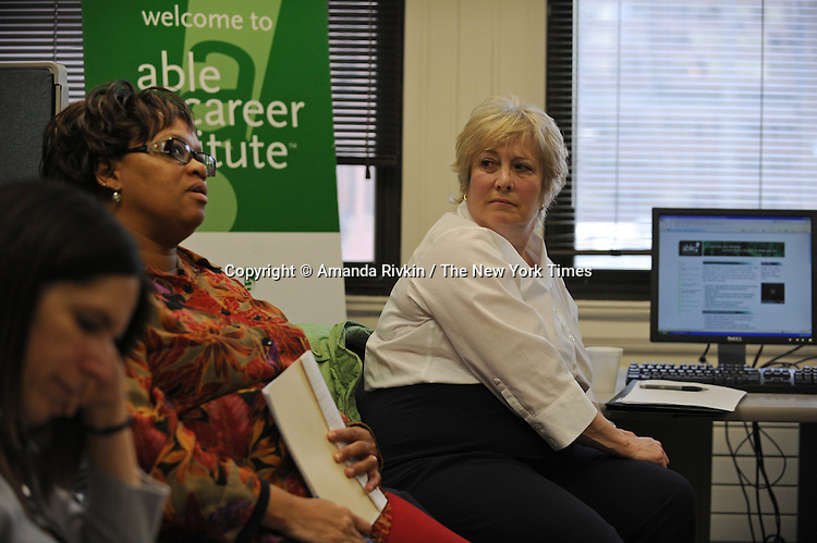 (Right) Rae Lynn Schneider, 61, sits during a motivational discussion and support group with other older women at the National Able Network in downtown Chicago, Illinois on March 24, 2009.  A retired former Chicago Public School teacher, Schneider returned to the workforce last fall working briefly in sales at American Girl Place, a job Schneider said she loved but given its seasonal nature Schneider has been forced back into the job market and is retooling her resume and building her skill base with the assistance of National Able Network programs.