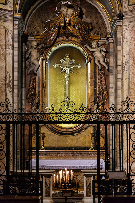 Alter shrine and tomb of Saint Camillus de Lellis with prayer candles, Santa Maria Maddalena, Rome, Italy