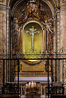 Alter shrine and tomb of Saint Camillus de Lellis with prayer candles, Santa Maria Maddalena, Rome, Italy