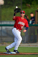 Auburn Doubledays first baseman Matthew Page (15) stretches for a throw during a game against the State College Spikes on July 6, 2015 at Falcon Park in Auburn, New York.  State College defeated Auburn 9-7.  (Mike Janes/Four Seam Images)