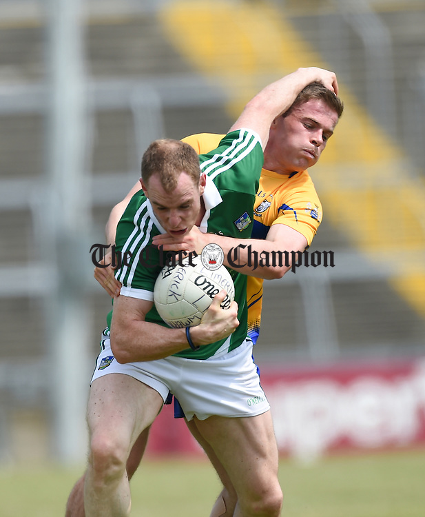 Seanie Buckley of Limerick in action against Sean Collins of Clare during their senior championship game at the Gaelic Grounds. Photograph by John Kelly.