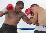 Jason Escalera from Union City, NJ, left, fights Norbert Nemesapati from Budapest, Hungary during the Super Middleweight bout Rural Rumble on Friday night, August 8, 2014 at Churchill County Fairgrounds in Fallon, Nevada.