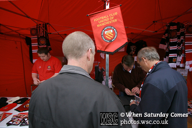 FC United of Manchester 8, Glossop North End 0, 28/10/2006. Gigg Lane, Bury, North West Counties League division one. Fans buying souvenirs before FC United of Manchester take on Glossop North End (blue shirts) in a North West Counties division one match at United's home stadium, Gigg Lane, home to Bury FC. The match was staged on People United Day, an event started in 1999 which brought together fans from across Europe to campaign against racism. FC United were formed in the summer of 2005 by supporters of Manchester United in response to the take over of their club by American millionaire Malcolm Glazer and his family. The club entered the football pyramid at the lowest level with the intention to climbing through the leagues. FCUM won the match 8-0, watched by 3257 spectators. Photo by Colin McPherson.