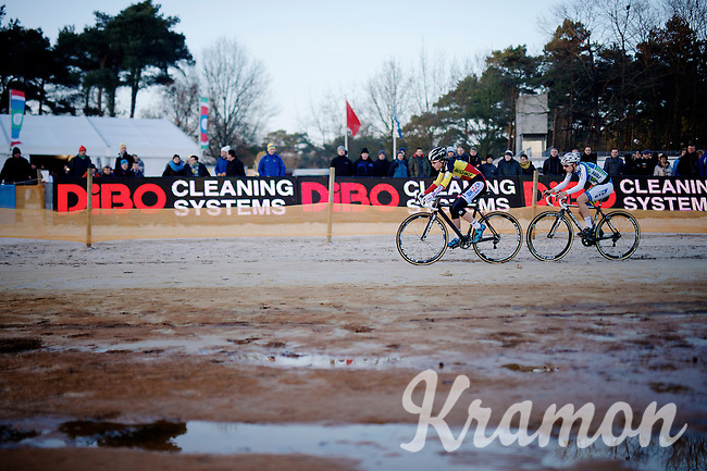 Sanne Cant (BEL/BKCP-Powerplus) followed closely by another competitor<br /> <br /> Zilvermeercross 2014