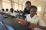 Students get help from a teacher in the computer lab at the Loreto Girls Secondary School in Rumbek, South Sudan. The school is run by the Institute for the Blessed Virgin Mary--the Loreto Sisters--of Ireland.