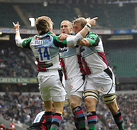 Twickenham, GREAT BRITAIN,  Quins, David STRETTLE, is congratulated by team mates, centre Mike BROWN and right, Chris ROBSHAW, after scoring the opening try in the first few minutes of the Guinness Premiership match,  Saracens vs Harlequins, at Twickenham Stadium, Surrey on Sat 06.09.2008. [Photo, Peter Spurrier/Intersport-images]