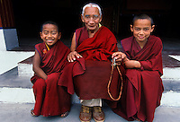 Three Tibetan Buddhist monks at Dip-Tse-Chok-Ling Monastery   <br /> Dharamsala, India 1998.<br /> With more than 6500 Tibetan Buddhist monasteries destroyed in Tibet after the 1959 Chinese invasion many of the monks and lamas have fled their homeland. New monasteries such as Dip-Tse-Chok-Ling Monastery in Dharamsala India have been rebuilt to house the exiled refugees and the new generation of enthusiastic young monks.