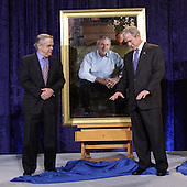 Washington, DC - December 19, 2008 -- United States President George W. Bush, right, with artist Robert Anderson after the unveiling of the painting at the National Portrait Gallery in Washington, D.C. on Friday, December 19, 2008.  .Credit: Ken Cedeno / Pool via CNP