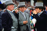 Racegoers drinking champagne at the Epsom Derby, Surrey