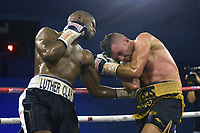 Luther Clay (black/white shorts) defeats Renald Garrido during a Boxing Show at Bracknell Leisure Centre on 8th July 2018