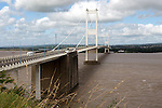 The old 1960s Severn bridge crossing between Aust and Beachley, Gloucestershire, England, UK looking west