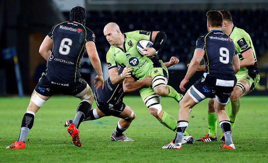 Northampton Saints Sam Dickinson under pressure from  Ospreys James King<br /> <br /> Photographer Simon King/CameraSport<br /> <br /> Rugby Union - European Rugby Champions Cup - Pool 5 - Ospreys v Northampton Saints - Sunday 18th January 2015 - Liberty Stadium - Swansea<br /> <br /> &copy; CameraSport - 43 Linden Ave. Countesthorpe. Leicester. England. LE8 5PG - Tel: +44 (0) 116 277 4147 - admin@camerasport.com - www.camerasport.com