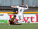 Alloa's Jason Marr pulls down Dumbarton's Andy Graham for their peamlty.