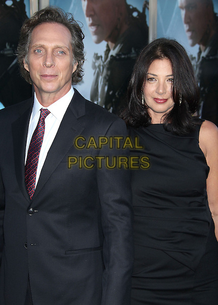William Fichtner &amp; guest <br /> &quot;Elysium&quot; Los Angeles Premiere held at the Regency Village Theatre, Westwood, California, UK,<br /> 7th August 2013.<br /> half length  white shirt red tie  <br /> CAP/ADM/RE<br /> &copy;Russ Elliot/AdMedia/Capital Pictures