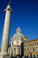 Trajan's Column with cathedral exterior in the background, Rome, Italy.