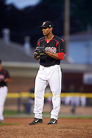 Batavia Muckdogs pitcher Nestor Bautista (39) gets ready to deliver a pitch during a game against the Auburn Doubledays July 8, 2015 at Dwyer Stadium in Batavia, New York.  Batavia defeated Auburn 4-1.  (Mike Janes/Four Seam Images)