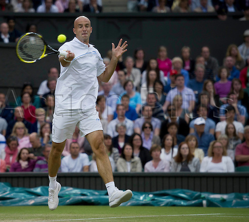 24.06.2011. Andy Murray GBR (4) v Ivan Ljubicic CRO. Ivan in action. The Wimbledon Tennis Championships held at The All England Lawn Tennis and Croquet Club.