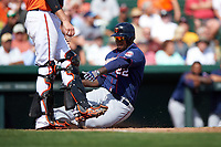 Minnesota Twins right fielder Miguel Sano (22) slides home to score a run during a Spring Training game against the Baltimore Orioles on March 7, 2016 at Ed Smith Stadium in Sarasota, Florida.  Minnesota defeated Baltimore 3-0.  (Mike Janes/Four Seam Images)
