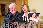 Noreen and Tim John Healy with a photo of their daughter Denise who survived the earthquake in Christchurch, New Zeland.
