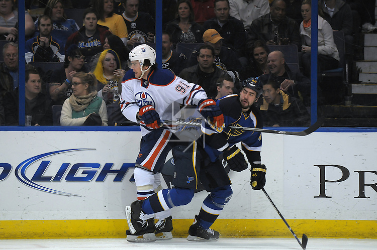Edmonton Oilers left wing Magnus Paajarvi (91) and St. Louis Blues defenseman Roman Polak (46) tangle in the second period during a game between the Edmonton Oilers and the St. Louis Blues on Tuesday March 26, 2013 at the Scottrade Center in downtown St. Louis.