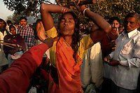 A woman performs black magic on the bank of river Gandak during Sonepur fair. Bihar, India, Arindam Mukherjee.
