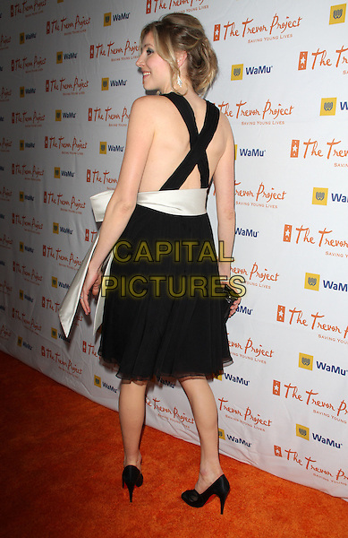 "SARAH CHALKE .11th Annual Trevor Project's ""Cracked XMas"" Benefit at the Wiltern Theatre, Los Angeles, California, USA..December 7th, 2008.full length black straps back behind rear shoes christian louboutin criss cross.CAP/ADM/KB.©Kevan Brooks/AdMedia/Capital Pictures."