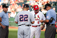 Manager Mike Shildt (8) of the Springfield Cardinals talks with the umpires and Manager Mike Micucci (22) of the Arkansas Travelers during a game against the Arkansas Travelers at Hammons Field on June 12, 2012 in Springfield, Missouri. (David Welker/Four Seam Images)
