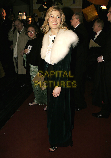 ROSAMUND PIKE.Official BAFTA Aftershow Dinner Party, .Grosvenor House, Park lane, London, .February 12th 2005..full length white fur wrap shrug cape colar shawl rosamond.Ref: AH.www.capitalpictures.com.sales@capitalpictures.com.©Capital Pictures.