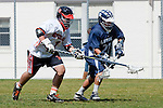 Beverly Hills, CA 04/12/10 - Amir Kashi (Beverly Hills # 1) and Joshua Belmont (Loyola # 22) in action during the Loyola-Beverly Hills Boys Varsity Lacrosse game at Beverly Hills High School, Loyola defeated Beverly Hills 16-0.