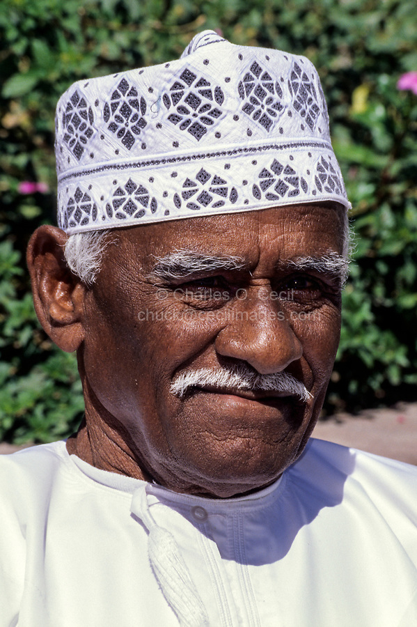 Muscat, Oman.  Middle-aged Man Wearing a Kuma, the Traditional Omani Hat.