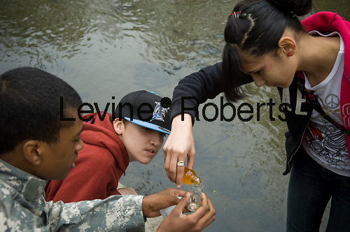 Bronx middle school students volunteer their time in Bronx Park in New York on Tuesday, April 13, 2010.  The students  test the water quality of the Bronx River   using the Winkler titration method to measure the dissolved oxygen in the water.  (© Frances M. Roberts)