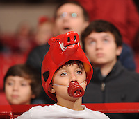 NWA Media/ANDY SHUPE - Brodie Janksi, 8, of Vilonia sits with his family as they wait for the start of the University of Arkansas men's basketball game against Northwestern State Sunday, Dec. 28, 2014, in the stands at Bud Walton Arena in Fayetteville.