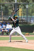 Oakland Athletics outfielder George Bell (64) at bat during an Instructional League game against the Los Angeles Dodgers at Camelback Ranch on October 4, 2018 in Glendale, Arizona. (Zachary Lucy/Four Seam Images)