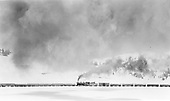 D&amp;RGW #487 as mid-train helper, probably near Los Pinos.  Very snowy scene.<br /> D&amp;RGW  Los Pinos, CO  Taken by Peyton, Ernie S. - 3/1948