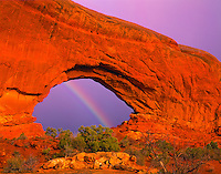 Rainbow at North Window, Arches National Park, Utah  Entrada sandstone    Windows Section sunset