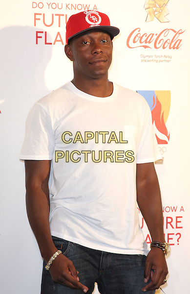 DIZZEE RASCAL (Dylan Kwabena Mills).'Future Flames' Coca Cola launches London 2012 Olympic Torch Relay nominations at Westfield Shopping Centre, London, England..June 1st 2011.half length white t-shirt red baseball cap hat.CAP/ROS.©Steve Ross/Capital Pictures
