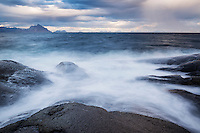 Waves crash over rocky coastline, Stamsund, Vestvågøya, Lofoten Islands, Norway
