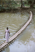 A Sri Lankan woman crosses a bridge in 1996.