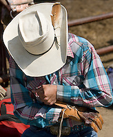 A cowboy get ready for his turn during the Miles City Bucking Horse Sale at the Eastern Montana Fairgrounds in Miles City Montana Sat., May 19, 2007. Saddle broncs and bareback broncs are auctioned off after they are bucked.